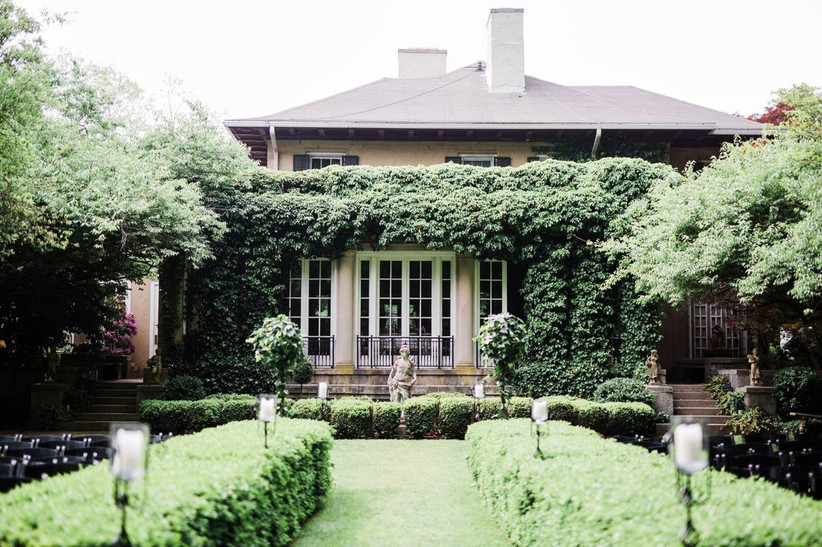 beautiful garden with hedges and sculptures