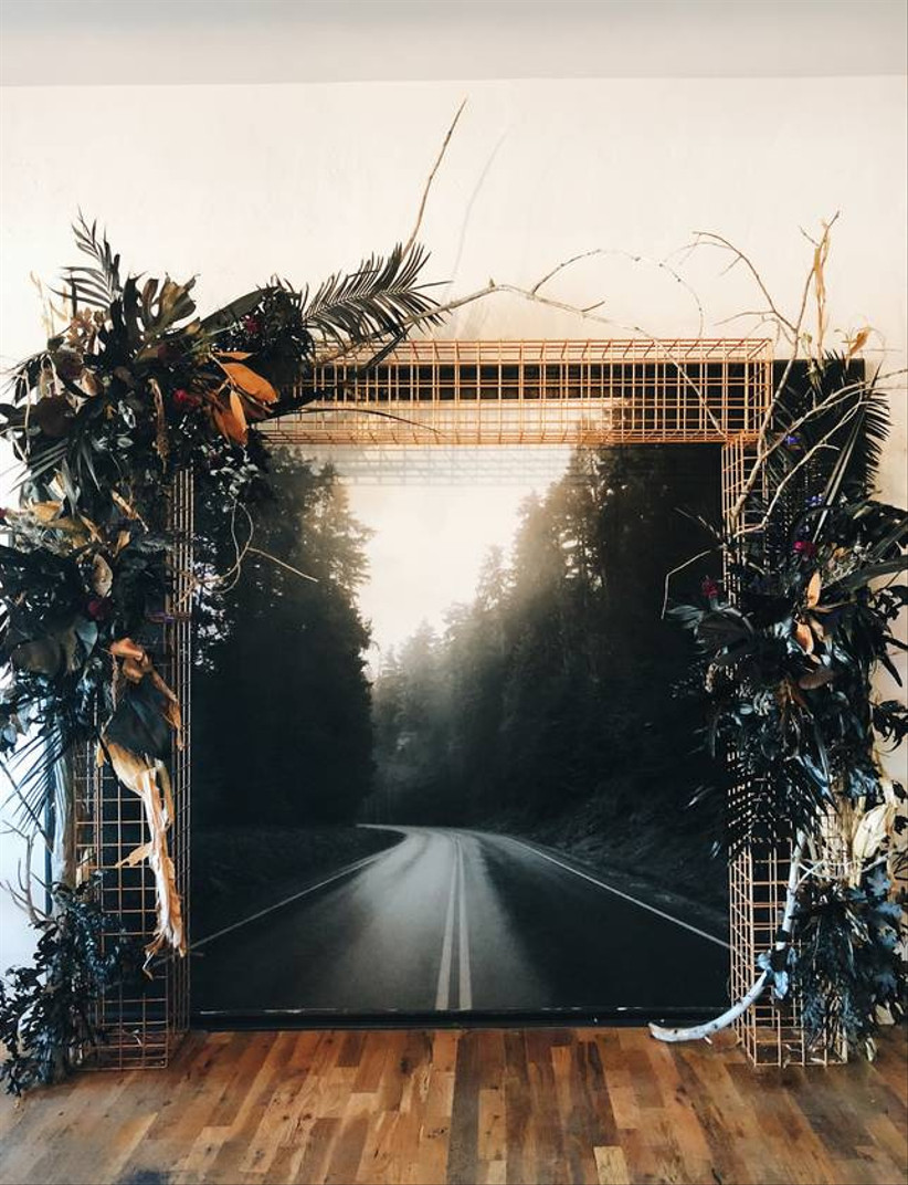 halloween themed wedding backdrop photo of deserted foggy road through a forest