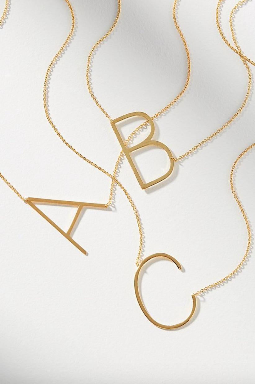 Monogram gold necklaces with A, B, and C