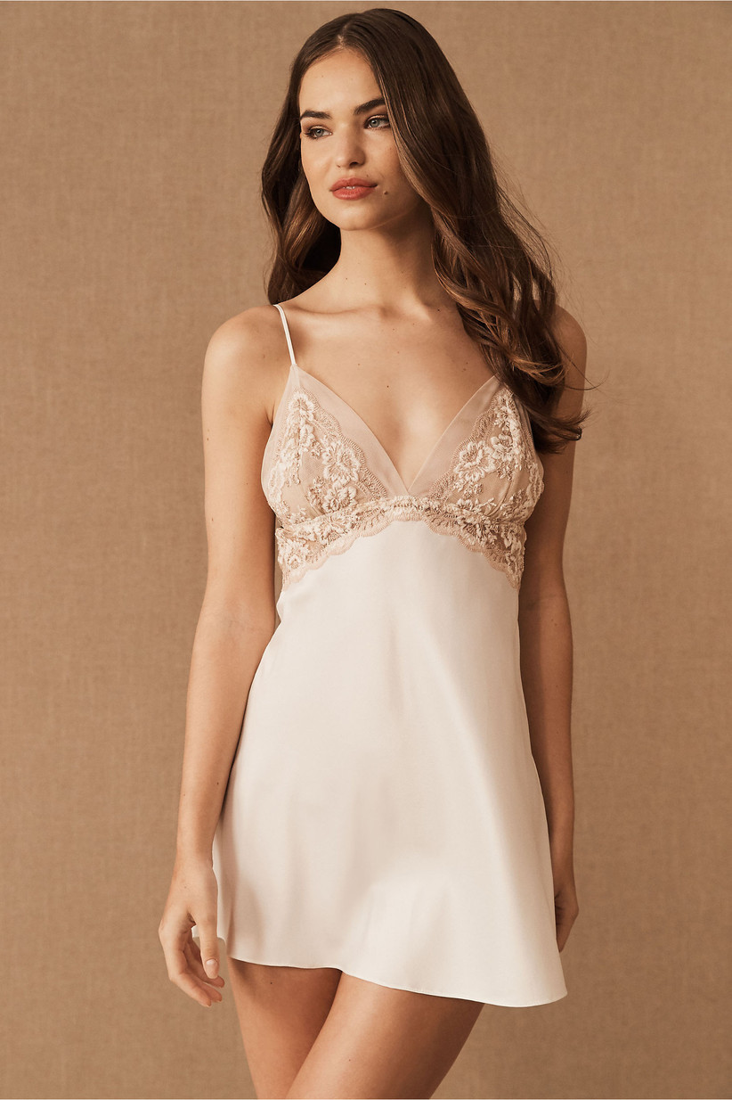 Model wearing elegant embroidered satin chemise