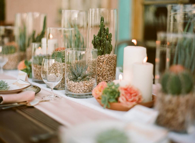 beach wedding centerpiece with assorted succulents and cactus in different size glass cylinder vases