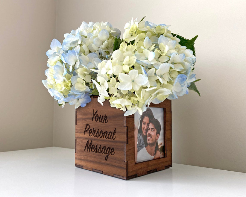 Flowers in wooden photo box engagement party centerpiece idea