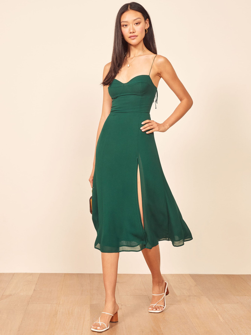 Emerald green midi with structured bodice and flowy skirt fall wedding guest dress