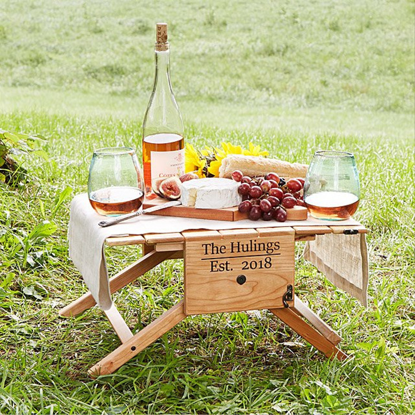 personalized wooden picnic table with food on top
