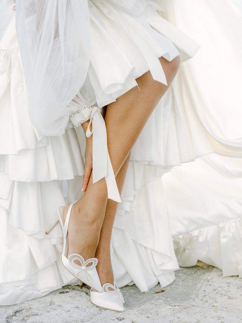 white slingback high heels on model