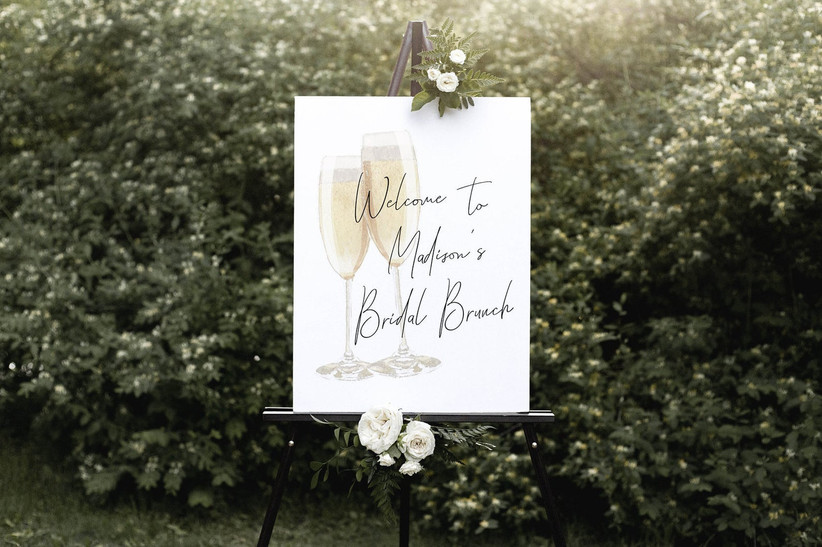 Elegant welcome sign on black easel that reads Welcome to Madison's Bridal Brunch
