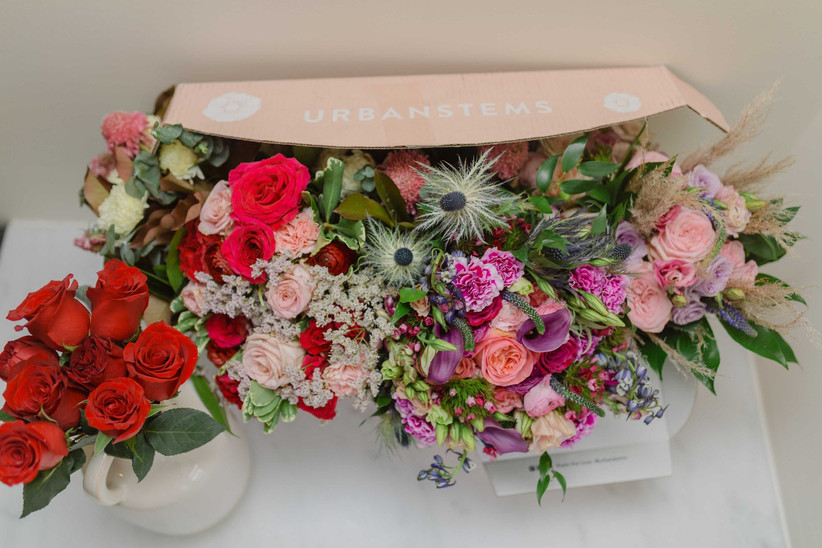 Bright bouquet of flowers emerging from UrbanStems delivery box