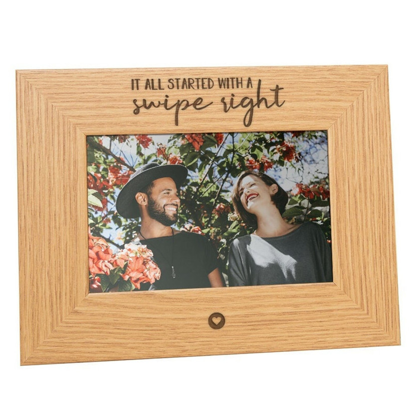 wooden picture frame with it all started with swipe right engraved on it