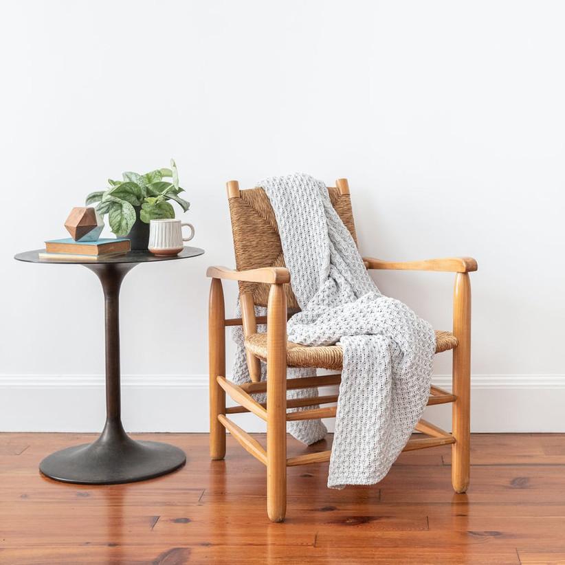 Throw blanket arranged on chair