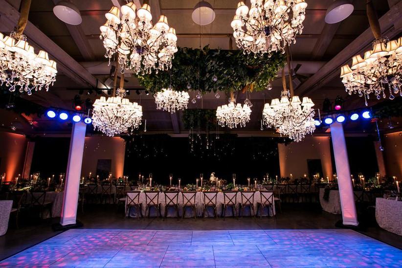 glam wedding lighting idea multiple chandeliers hanging over dance floor