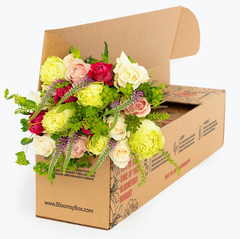 Bouquet of beautiful flowers in delivery box