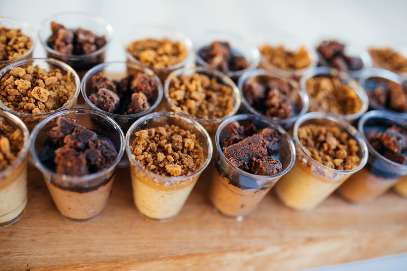 pudding cups and parfaits topped with graham cracker crumbles, cookies, and brownies