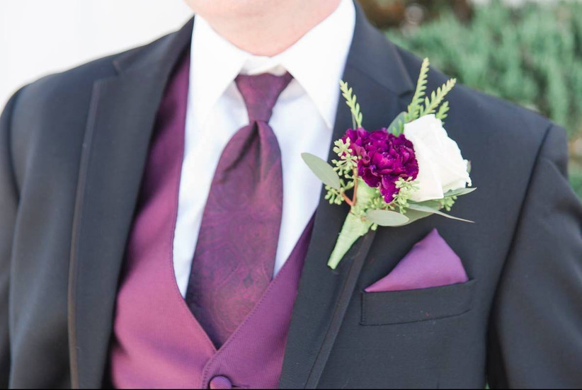 purple carnation boutonniere with white rose and greenery