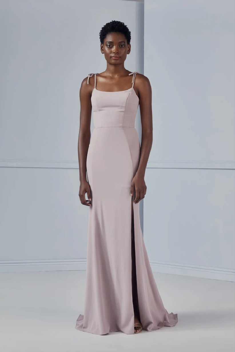 Model wearing minimalist pastel purple bridesmaid dress with tie-at-the shoulder straps