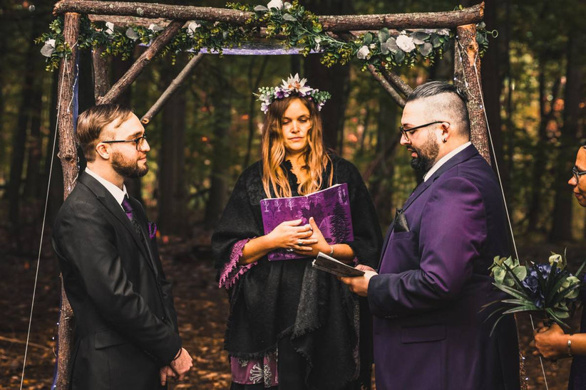 two grooms reciting wedding vows