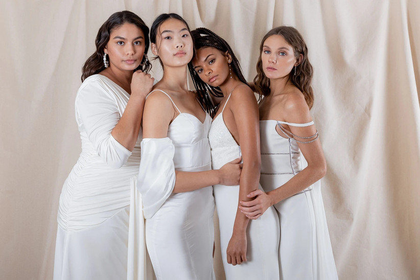 Four models wearing various dresses from Katharine Polk's bridal collection