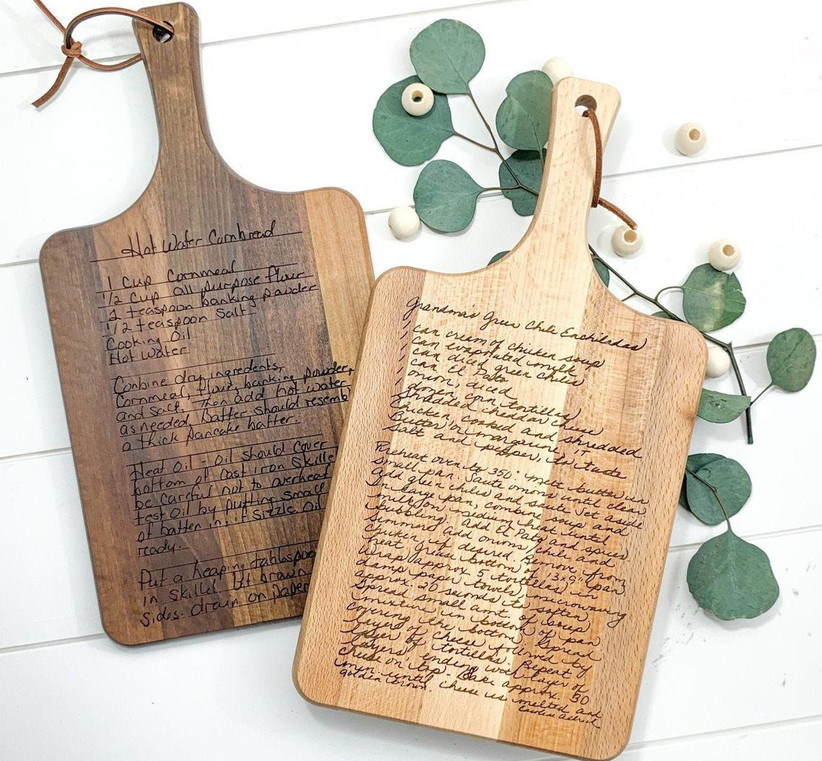 Two wooden cutting boards engraved with a custom handwritten recipe