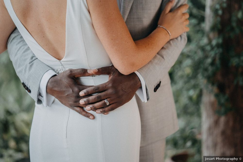 groom's hands around bride's waist