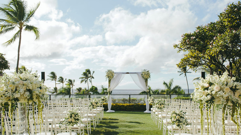 glamorous outdoor wedding ceremony with white rose aisle markers and chiavari chairs