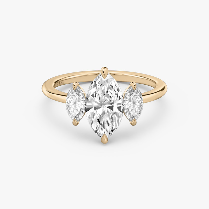 three stone engagement ring with marquise diamonds