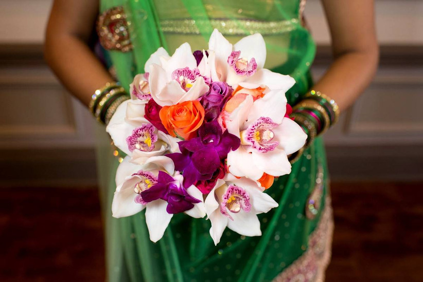 fall wedding bouquet with purple and white orchids, and orange roses