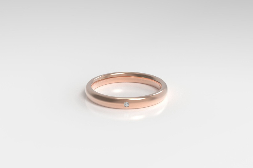 Minimalist rose gold band with small diamond accent