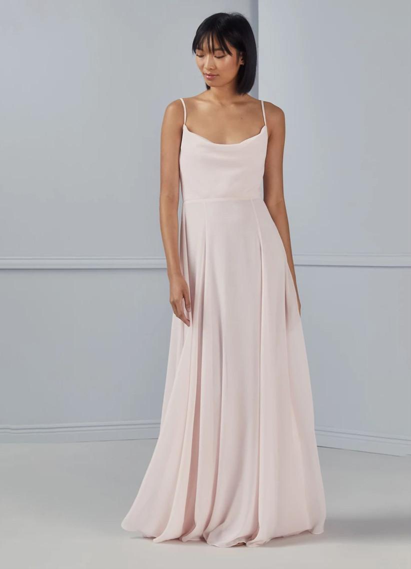 Light pastel pink chiffon bridesmaid dress with cowl neckline and spaghetti straps