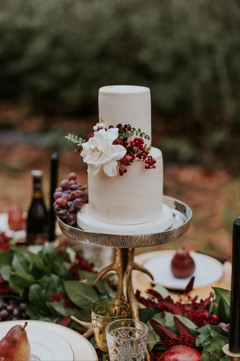 winter wedding cake decorated with red berries