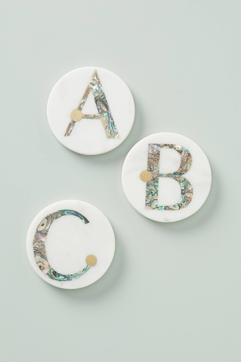White round coasters with monograms A, B. and C in colorful marble design