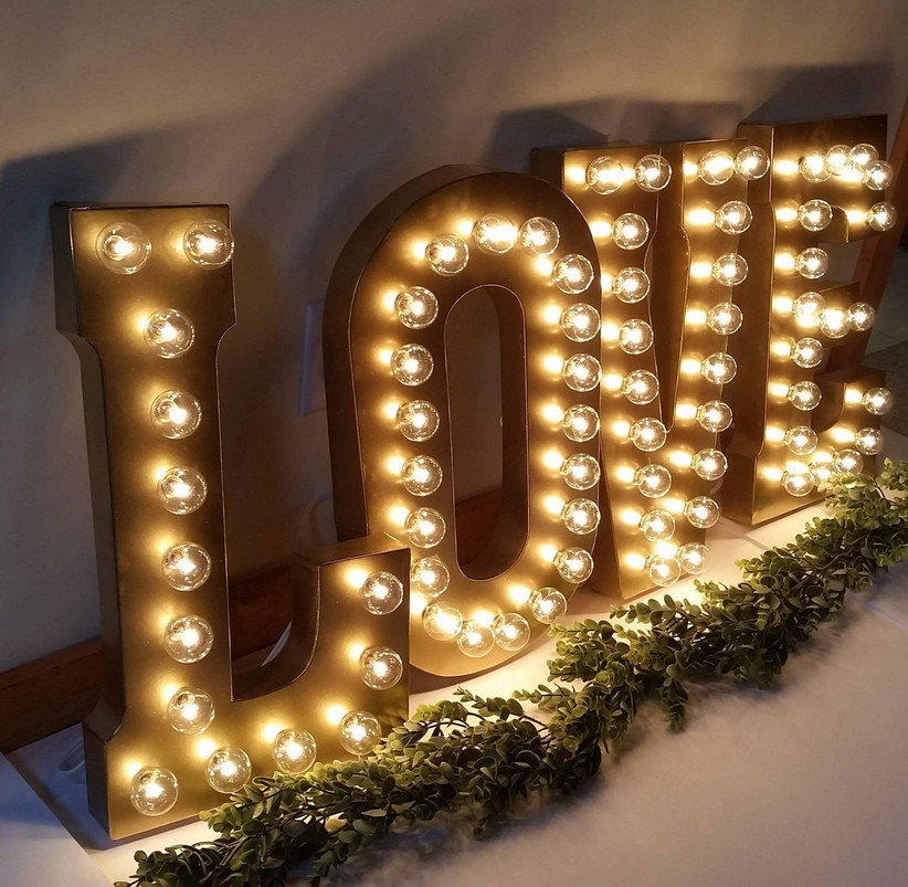 Giant light-up marquee letters that spell Love