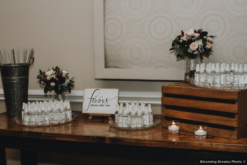 wedding favor table with individual bottles of hand sanitizer