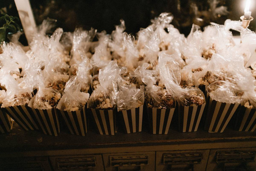 halloween themed wedding idea popcorn favors in black and white striped paper cartons