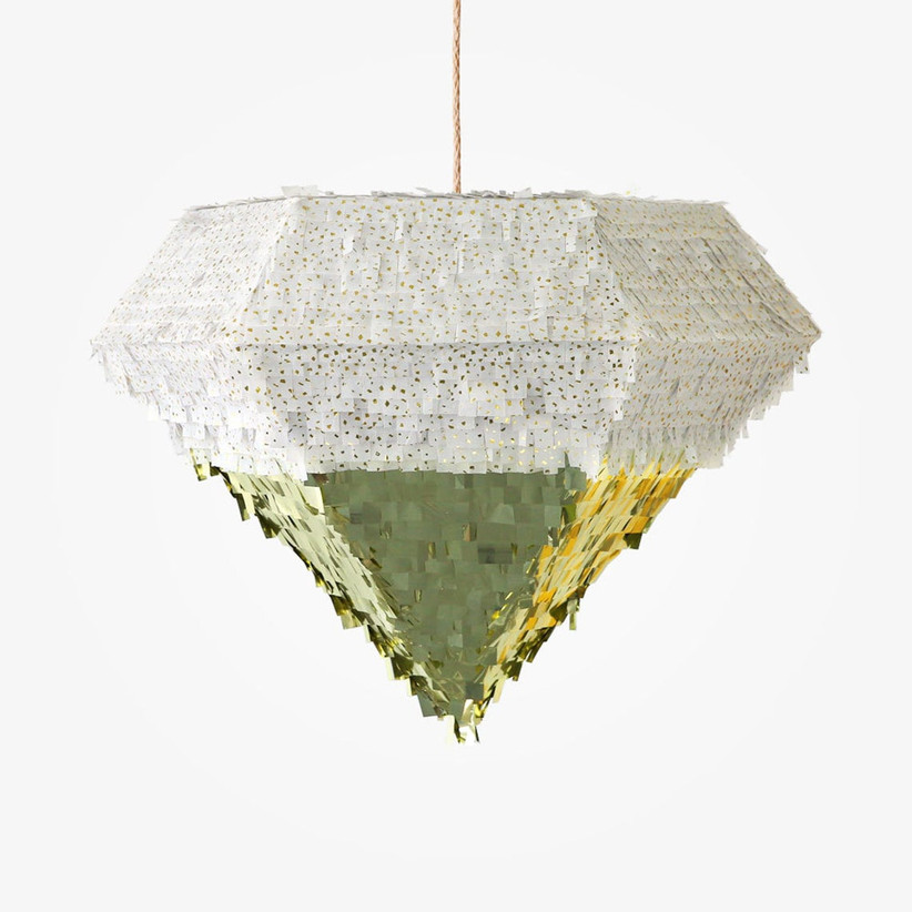 large diamond-shaped piñata decorated with white and gold metallic foil