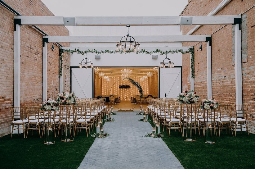 outdoor wedding ceremony with brick walls and industrial feel