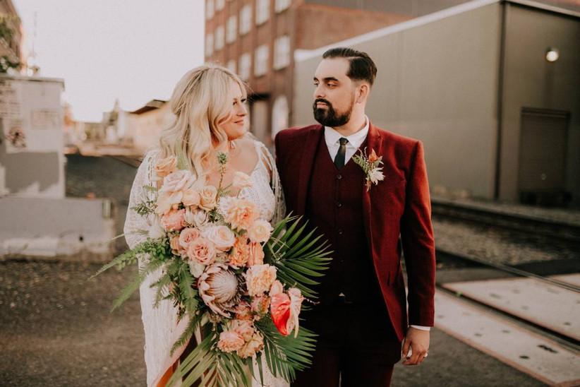 boho wedding groom wearing dark red three-piece suit