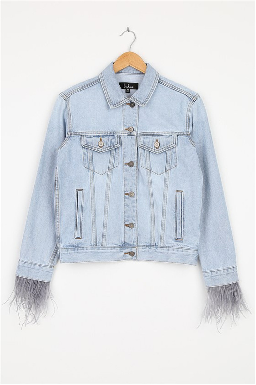 denim jacket with pale purple feather fringe on sleeve cuffs