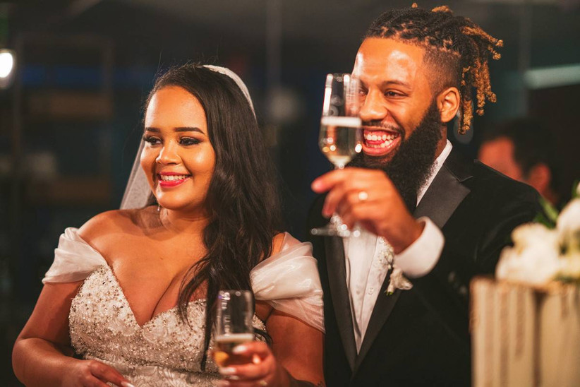 bride and groom toasting during wedding reception