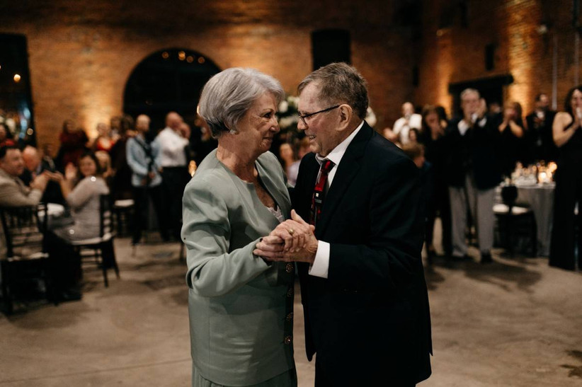 elderly couple dancing at a wedding