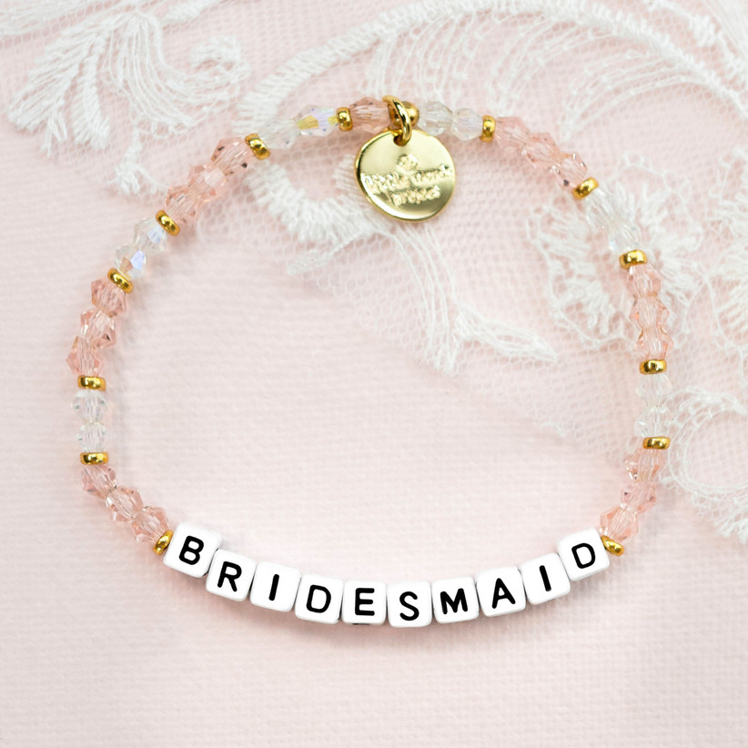 Pretty pink and gold beaded bracelet with BRIDESMAID on white square beads in black lettering