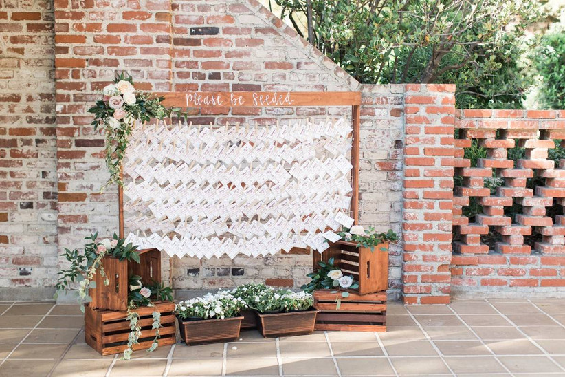 seed packet wedding escort cards on clothesline with clothespins