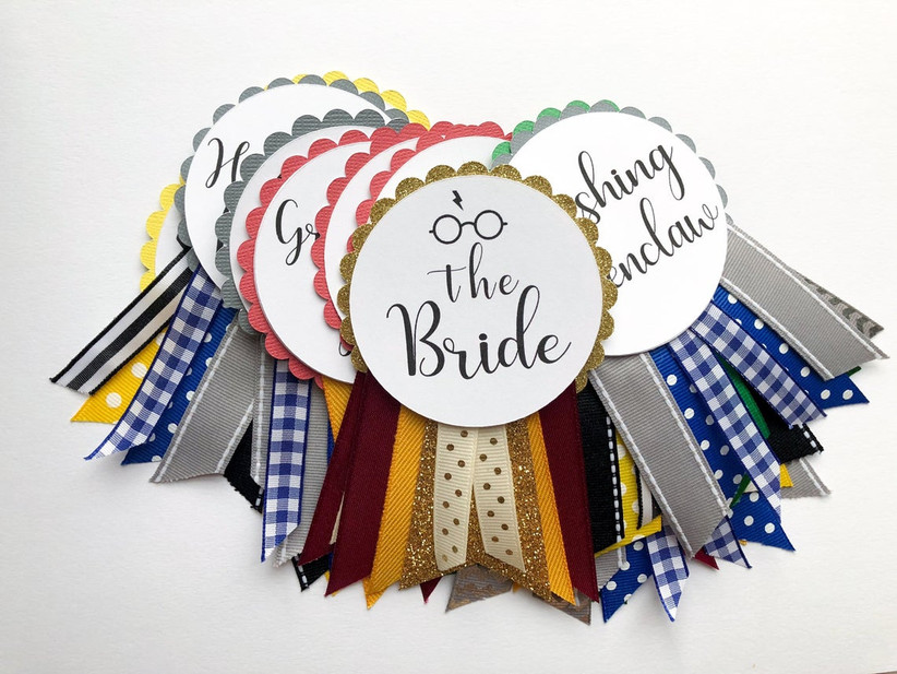 custom harry potter bachelorette party badges with ribbons in hogwarts house colors