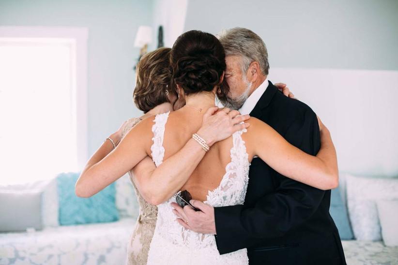bride hugging her parents