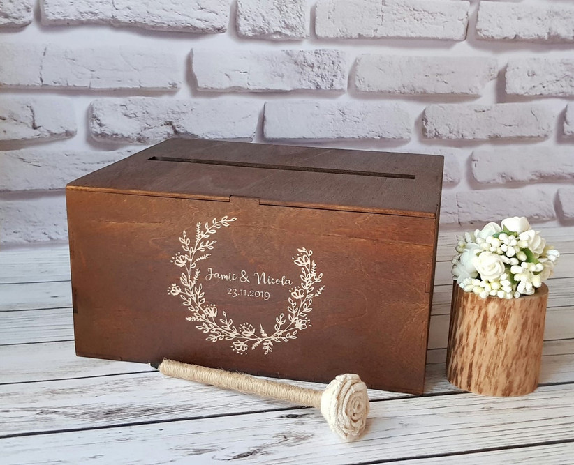 rustic wedding card box with laurel wreath and couple's names engraved on front