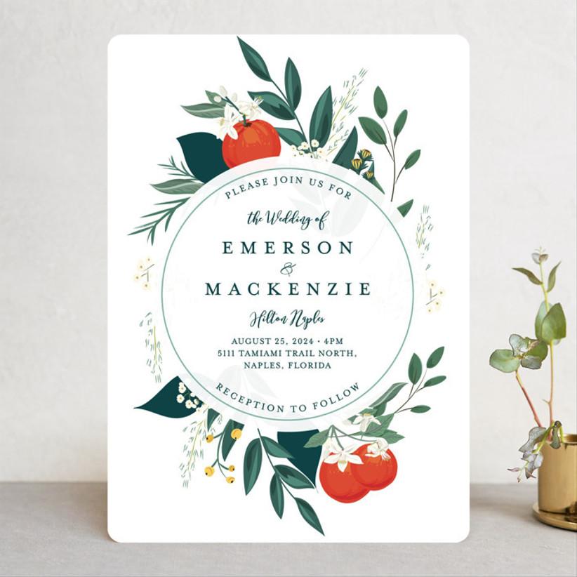 whimsical summer wedding invitation with greenery and orange citrus fruit print border