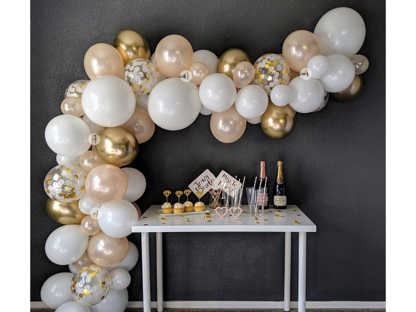 Champagne-hued balloon arch
