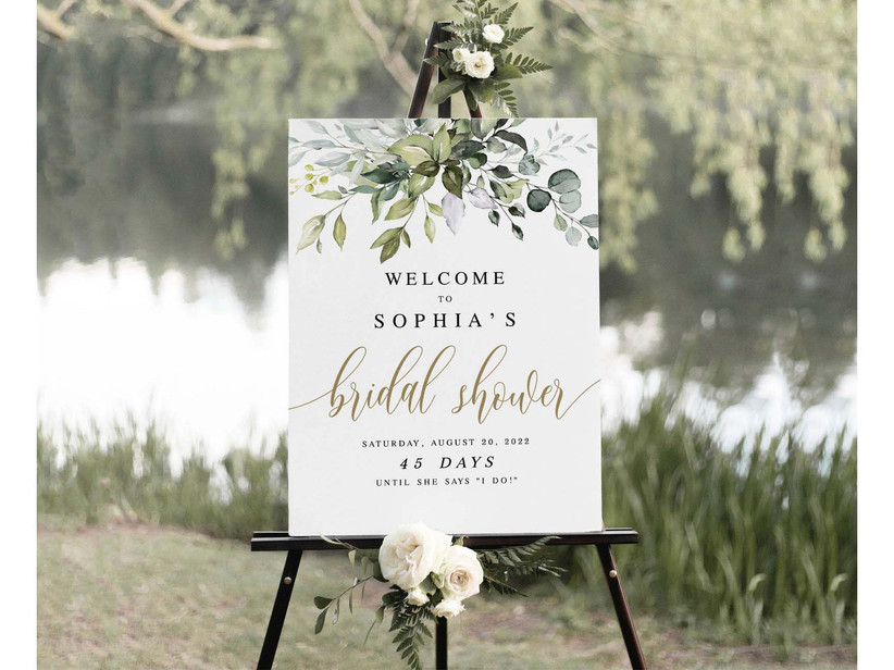 greenery bridal shower sign on easel