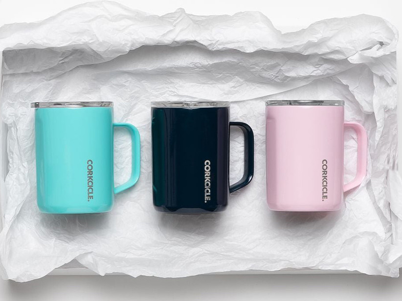 Three Corkcicle travel mugs in blue, black, and pink wedding vendor thank-you gift idea