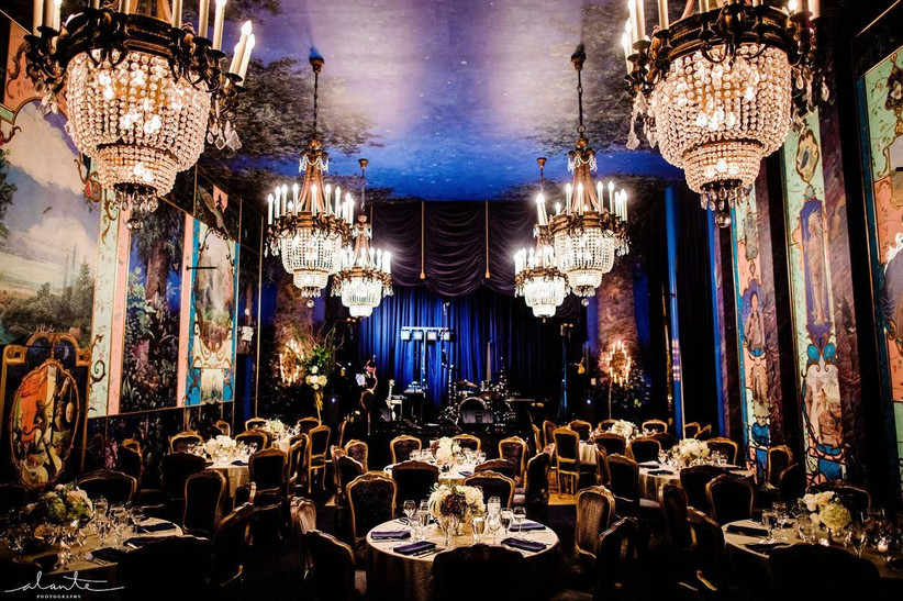 vintage ballroom wedding venue with rows of chandeliers and murals on the walls