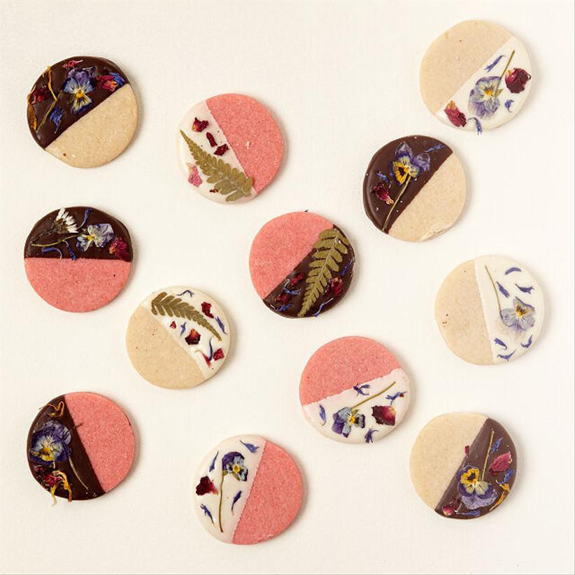 handmade sugar cookies dipped in chocolate with edible flowers