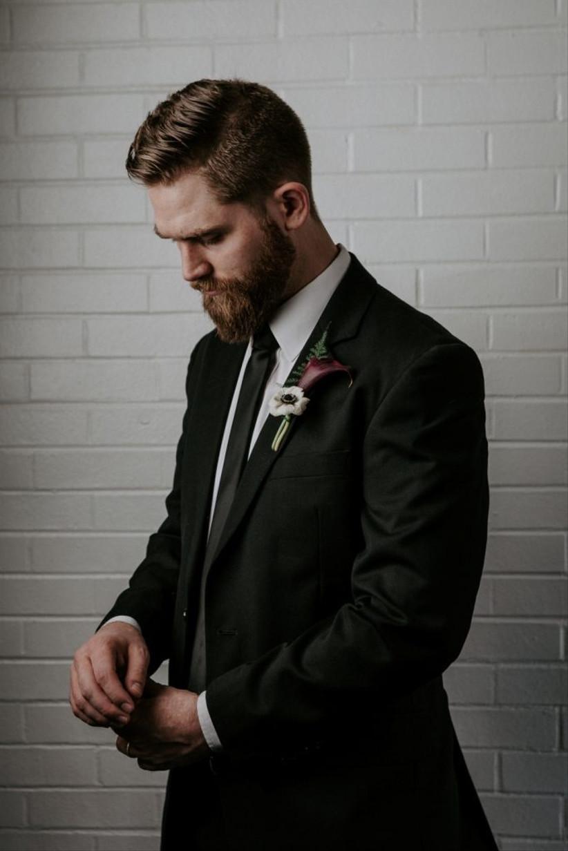 groom wearing black suit